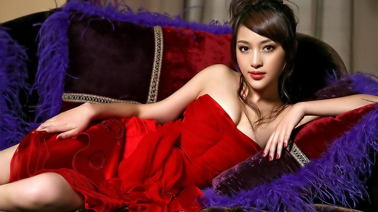 Seductive Chinese babe in a hot red dress