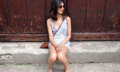 Cuban girl sitting on the street