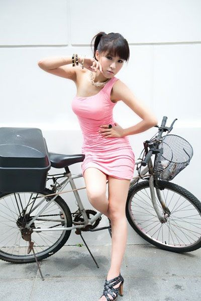 Betty Zhou leaning on a bicycle