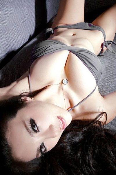 Gang Xiao Xi lying with gray bikini