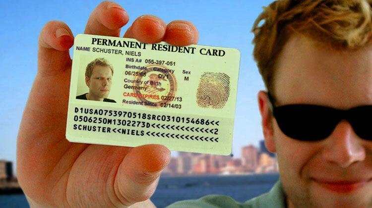 man holding a green card