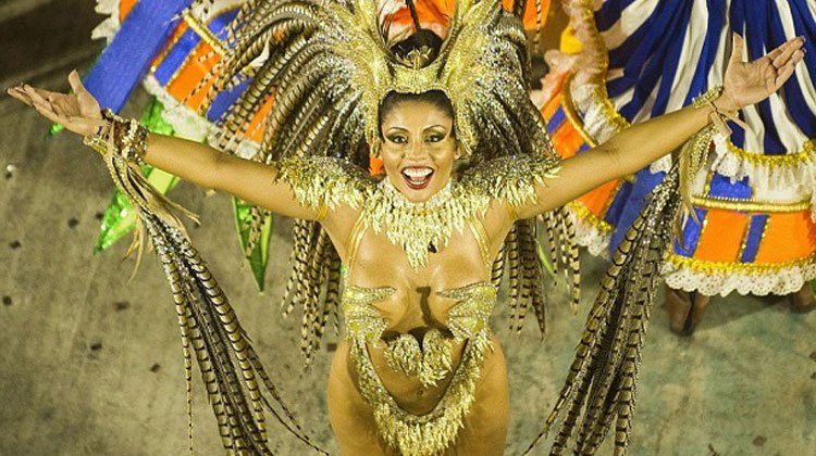 appealing Brazilian girl wearing gold costume in a carnival