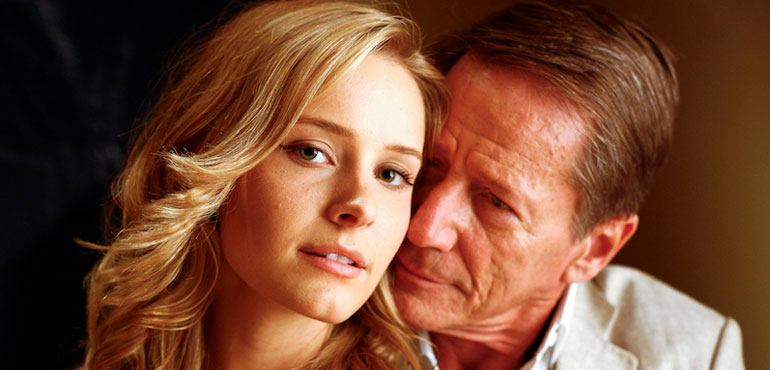 Old man with a young blonde, beautiful girl