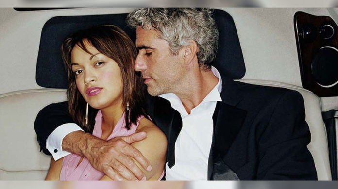 sugar daddy and his woman inside the car