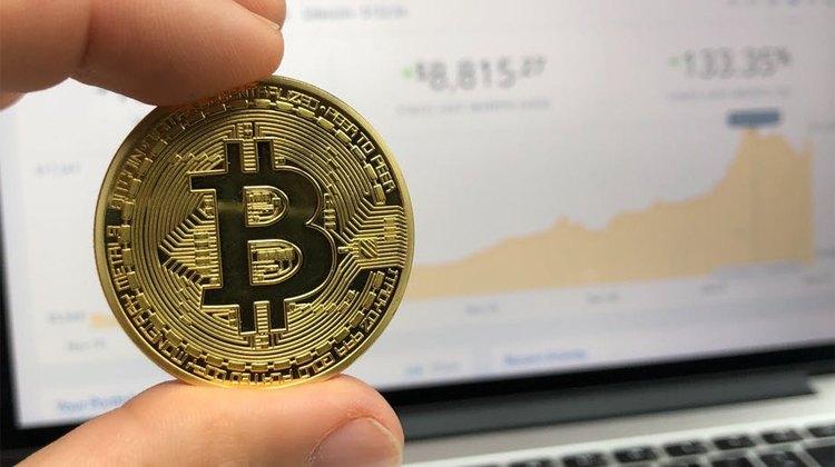 holding-a-bitcoin
