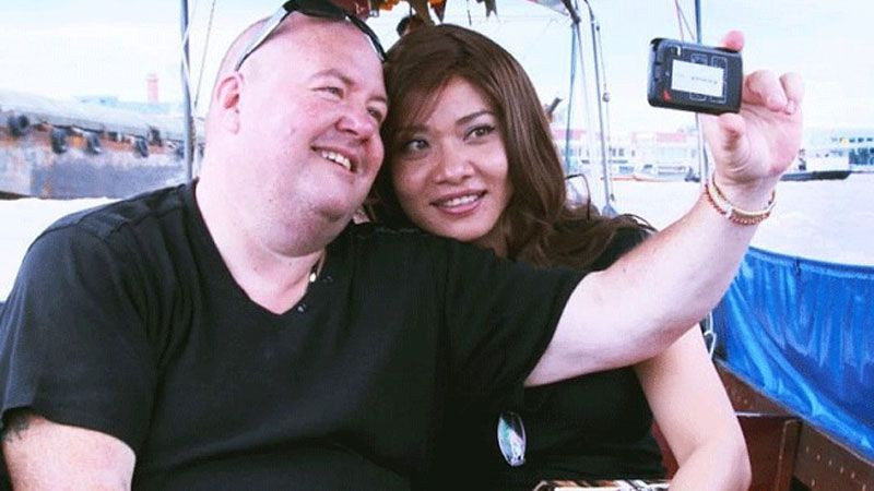 Thai girl and American guy taking selfie