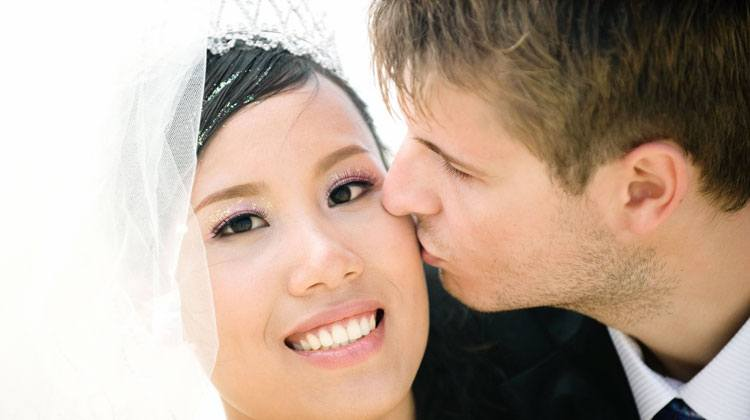 Western man kissing his lovely Chinese wife
