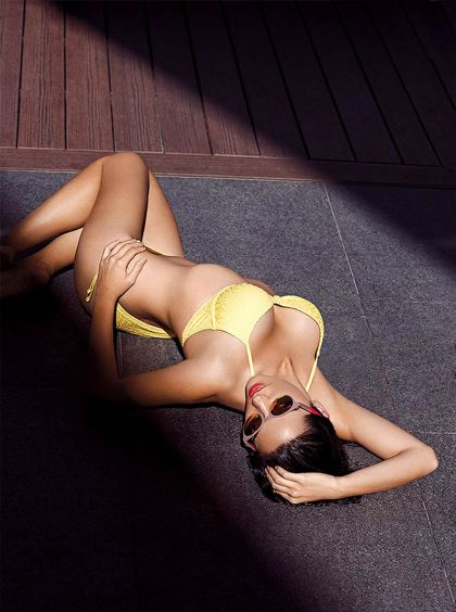 Maite Perroni pretty in yellow two piece bikini