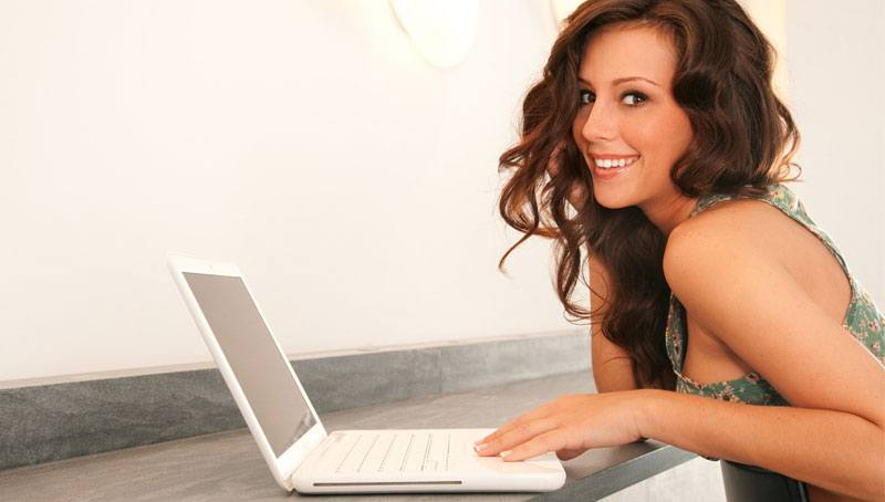 attractive Russian girl on a laptop