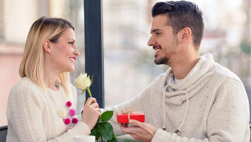 man-giving-flowers-and-gift-to-his-girl