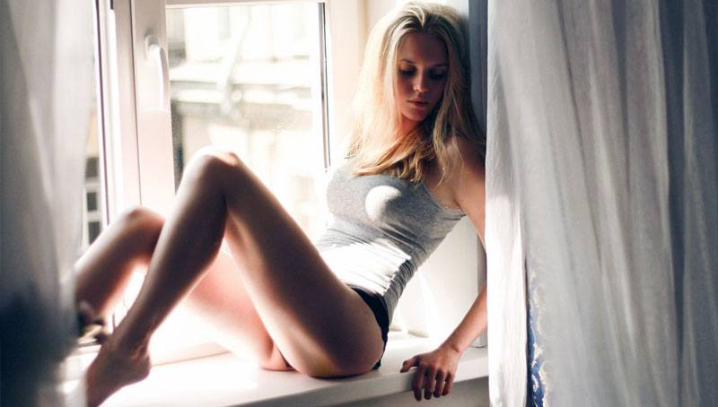 sexy-blonde-ukraine-girl-at-the-window