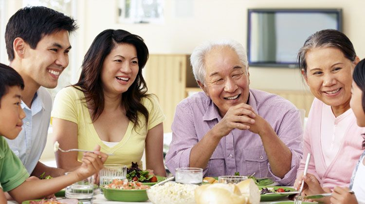 Asian family eating