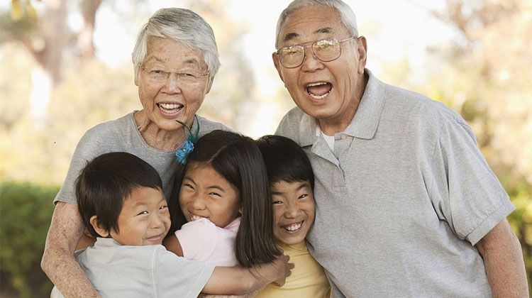 happy Asian grandparents with their grandkids