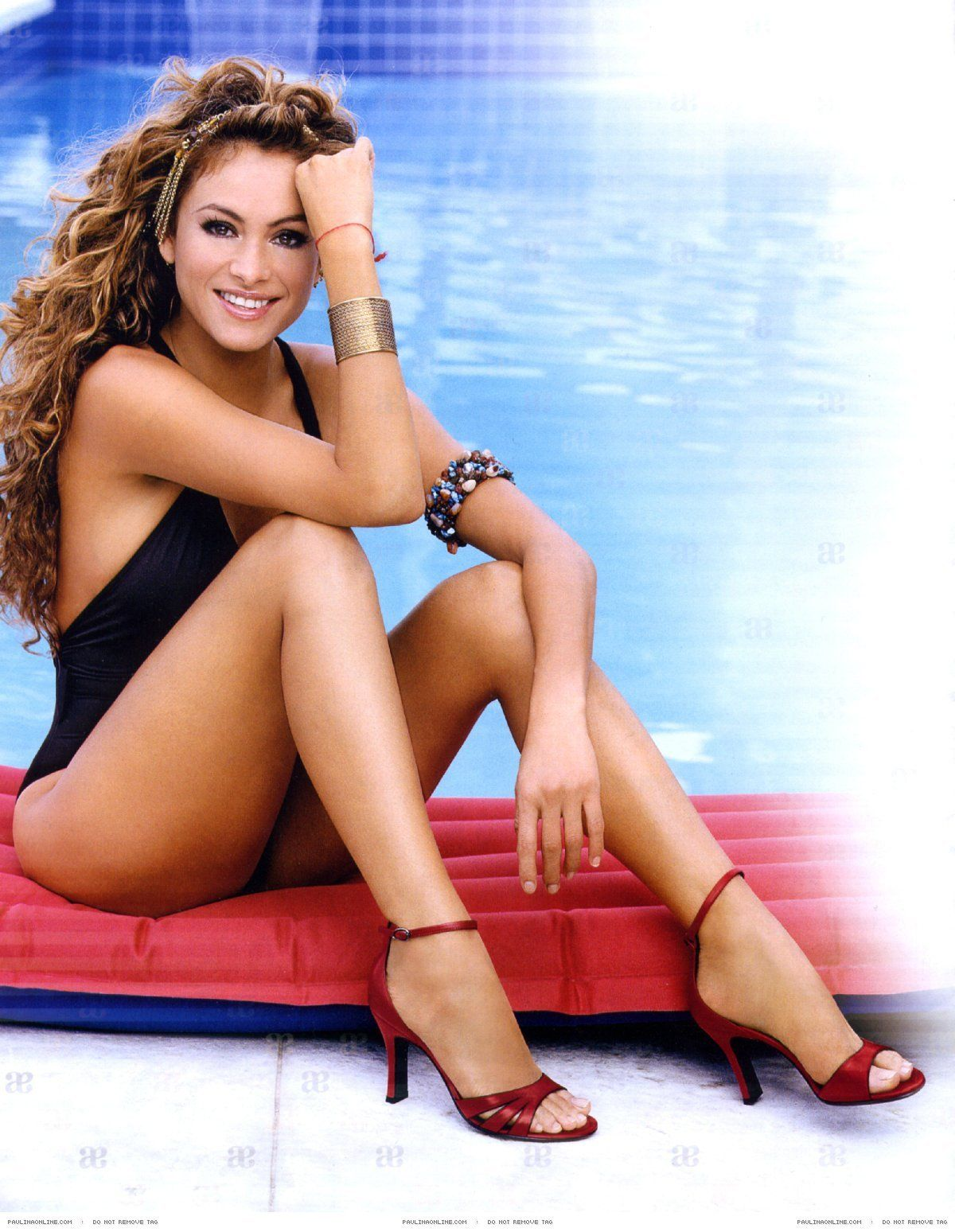 Paulina Rubio near the pool