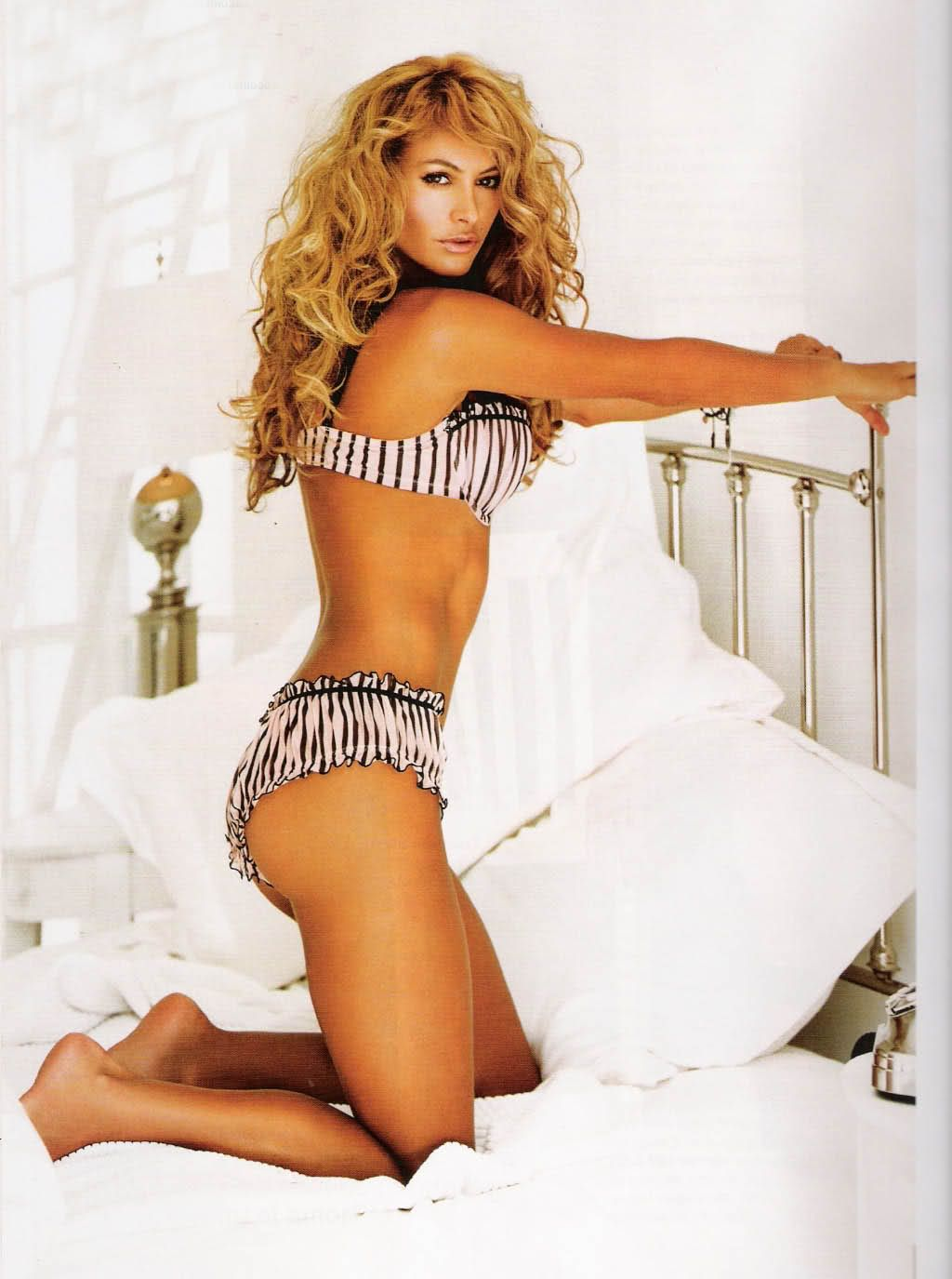 Paulina Rubio on the bed