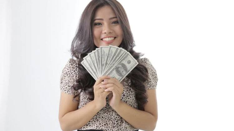 pretty Chinese woman holding a lot of money