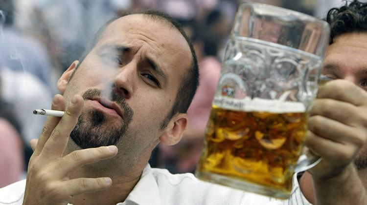 unattractive smoking and drinking Euro guy