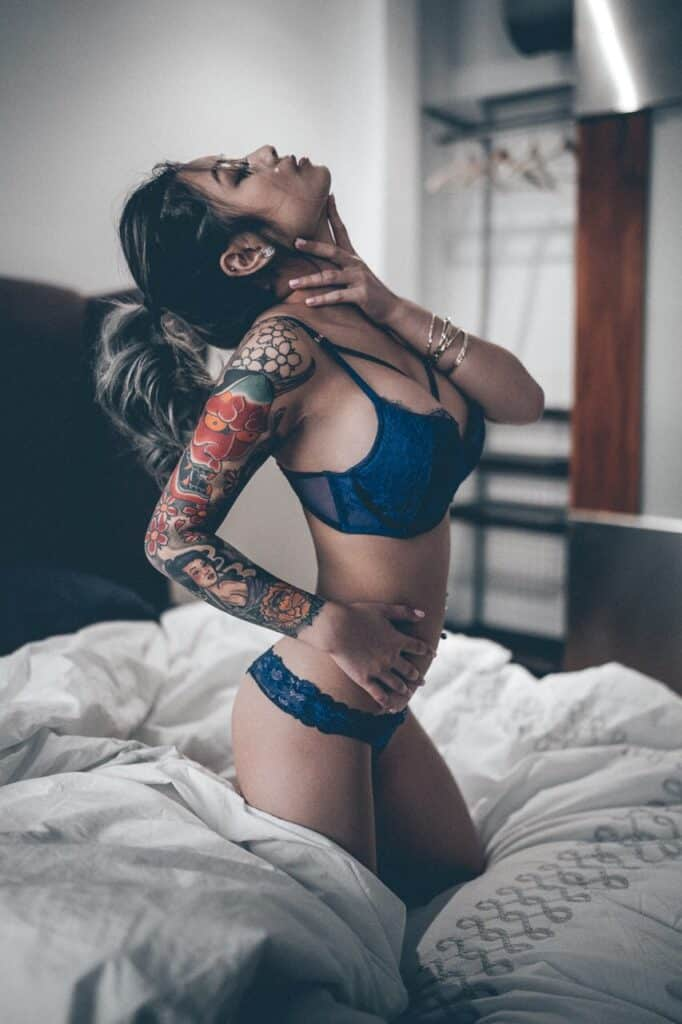 Jessica Hien Cambodian tattoo girl on the bed