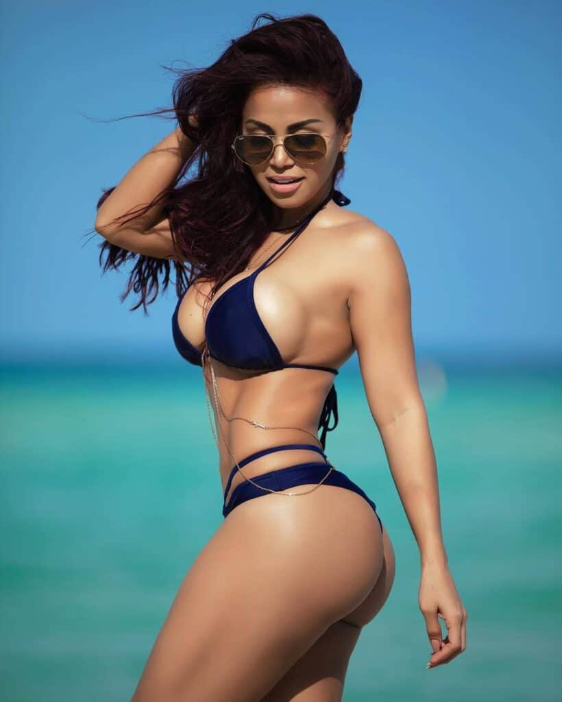 Dolly Castro in blue two piece at the beach