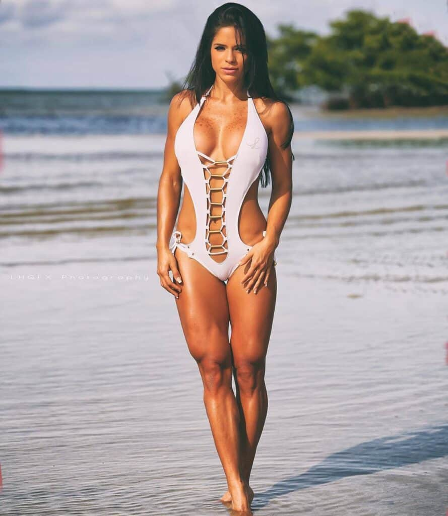 Michelle Lewin at the beach with a sexy white bikini