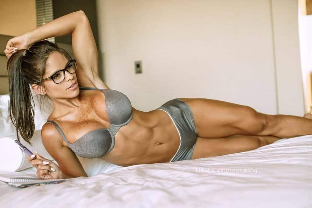 Michelle Lewin seductively hot body on the bed